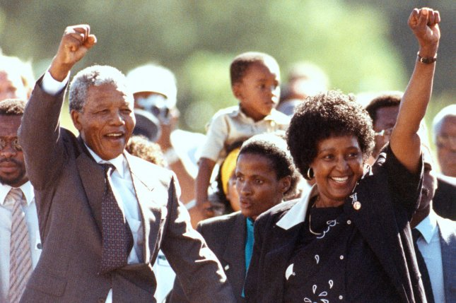 Nelson Mandela (L) and his wife Winnie salute supporters after the anti-apartheid activist was freed after 27 years in prison on Feb. 11, 1990. File photo/UPI