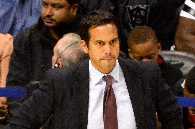 Miami Heat head coach Erik Spoelstra watches during the first half of their NBA game against the Atlanta Hawks at Philips Arena in Atlanta, November 14, 2014. UPI/David Tulis