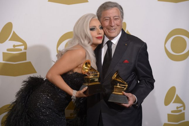 Lady Gaga and Tony Bennett appear backstage at the Staples Center in Los Angeles Feb.8, 2015, with the Grammy Awards they won for Best Traditional Pop Vocal Album, Cheek To Cheek. The Grammys have been presented annually since the first awards on May 4, 1959. File Photo by Phil McCarten/UPI