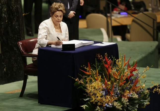 Brazilian President Dilma Rousseff, shown here signing the Paris Agreement on Climate Change at the headquarters of the United Nations in New York City on April 22, characterizes her impeachment as a coup. Photo by John Angelillo/UPI
