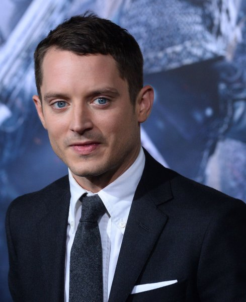 Elijah Wood attends the premiere of The Hobbit: The Battle of Five Armies at TCL Chinese Theatre in Los Angeles on December 9, 2014. Wood told Conan O'Brien that he is surprised that people still compare him to Daniel Radcliffe. File Photo by Jim Ruymen/UPI