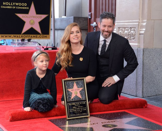Amy Adams (C) with husband Darren Le Gallo (R) and daughter Aviana at her Hollywood Walk of Fame ceremony on Wednesday. Photo by Jim Ruymen/UPI