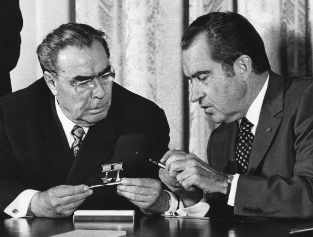President Richard Nixon and Soviet Communist Party Chief Leonid Brezhnev exchange pens used in signing an agreement on June 22, 1973, to avoid military confrontations and threats of force that might trigger nuclear war. The ceremony was in the East Room of the White House in Washington. Photo by Frank Cancellare/UPI