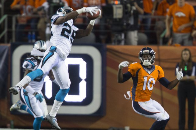 Former Carolina Panthers cornerback Bene Benwikere (25) intercepts a pass intended for Denver Broncos wide receiver Emmanuel Sanders (10) during the third quarter in the NFL's season opener and Super Bowl 50 rematch on September 8, 2016 at Sports Authority Field at Mile High in Denver. File photo by Gary C. Caskey/UPI