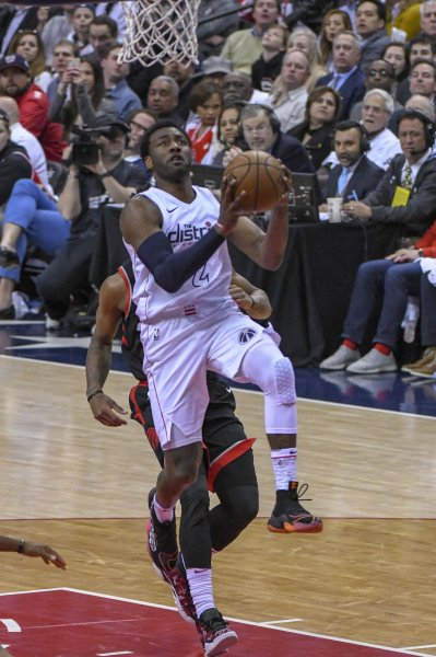 Washington Wizards guard John Wall goes to the basket in the first half against the Toronto Raptors at Capital One Arena in Washington, D.C. on Friday during the first round of the NBA playoffs. Photo by Mark Goldman/UPI