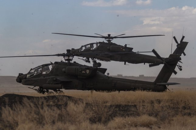 The State Department approved a possible sale of equipment supporting AH-64E Apache helicopters, like those pictured here, to India. File Photo by Brian Harris/U.S. Army/UPI