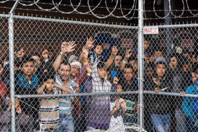 Migrants being held for processing under the Paso del Norte Bridge in El Paso on March 27, 2019. Photo by Justin Hamel/UPI