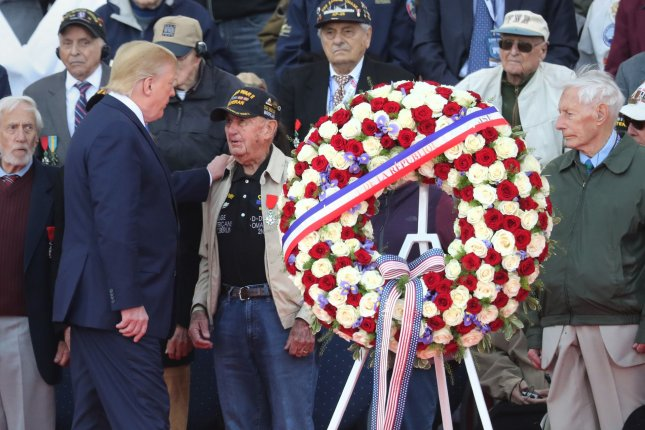 U.S. President Donald Trump greets a veteran at the ceremony commemorating the 75th anniversary of the D-Day landing. Photo by Eco Clement/UPI