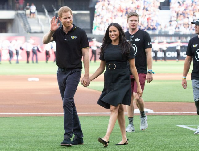 The Duke and Duchess of Sussex -- Prince Harry and Meghan Markle -- walk on the field when the New York Yankees play the Boston Red Sox at the London Stadium on June 29. File Photo by Mark Thomas/UPI
