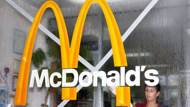 Jessica Mato is seen through a rain drenched window at a McDonalds outside of Atlantic City August 27, 2011 UPI/John Anderson