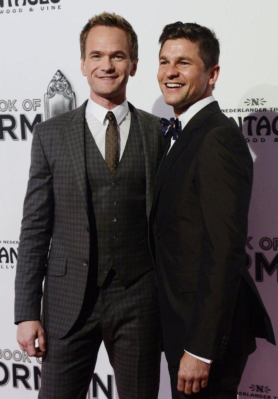 Neil Patrick Harris (L) and husband David Burkta will both guest star on 'American Horror Story: Freak Show.' (UPI/Jim Ruymen)
