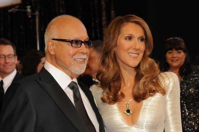 Celine Dion (R) and husband Rene Angelil at the Academy Awards on February 27, 2011. File photo by Jim Ruymen/UPI