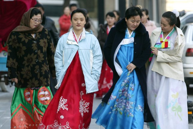 North Korean women dressed in traditional dresses leave the restaurant they work at and head to the North Korean Embassy in Beijing, China. A 45-year-old North Korean woman and defector said in August she is seeking repatriation, but Seoul has denied the request, citing current South Korean law. File Photo by Stephen Shaver/UPI