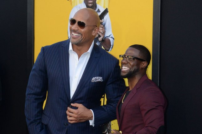 705286b347eb Cast members Dwayne Johnson (L) and Kevin Hart attend the premiere of the  motion picture comedy