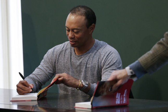 Tiger Woods signs a copy of his book, The 1997 Masters: My Story, at the Union Square Barnes & Noble in New York City on March 20, 2017. File photo by John Angelillo/UPI