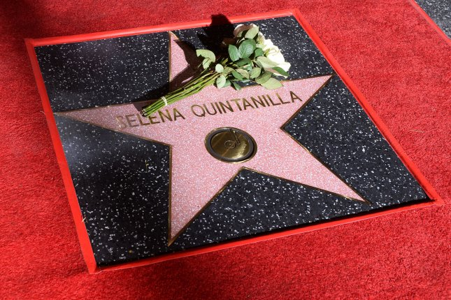 Flowers are left by Selena's husband Chris Perez during an unveiling ceremony honoring Tejano singer Selena Quintanilla with a posthumous star on the Hollywood Walk of Fame in Los Angeles on November 3. Photo by Jim Ruymen/UPI