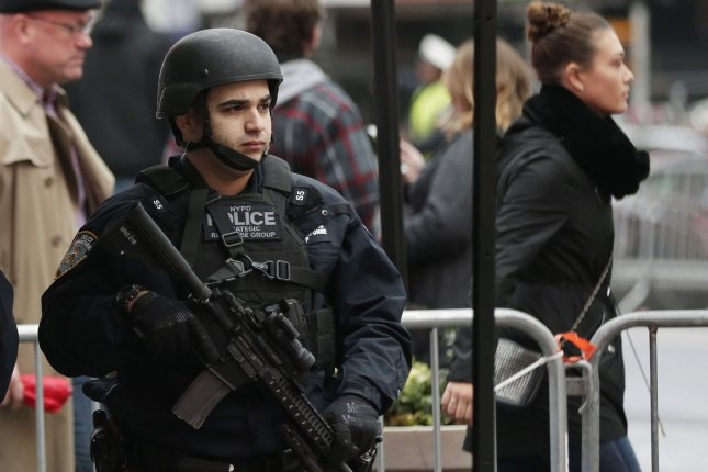 An NYPD Strategic Response Group Officer stands in Times Square one day after after a bomb exploded in The Port Authority Bus Terminal in the morning in New York City on Tuesday. Photo by John Angelillo/UPI