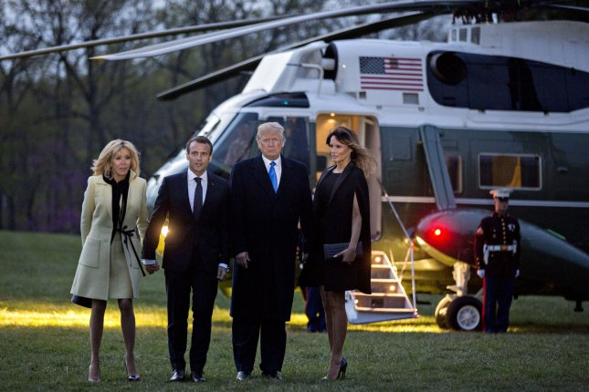 French President Emmanuel Macron and first lady Brigitte Macron (L) and U.S. President Donald Trump and first lady Melania Trump (R) returned to the White House after visiting Mount Vernon and the gravesite of George Washington. Photo by Andrew Harrer/UPI