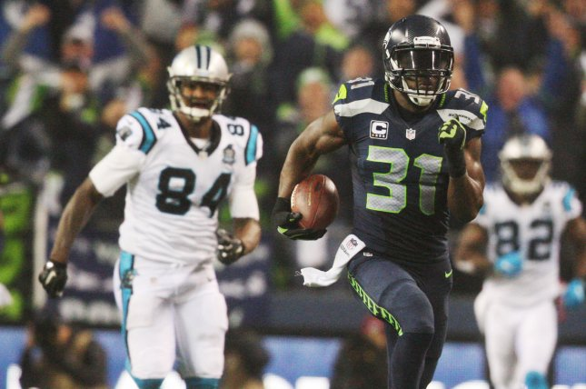 Seattle Seahawks strong safety Kam Chancellor (31) returns an interception 90 yards for a touchdown against the Carolina Panthers in the first round of the playoffs on January 10, 2015 at CenturyLink Field in Seattle, Washington. File photo by Jim Bryant/UPI