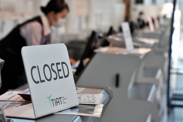 Closed signs are seen at check-in counters at Tokyo International Airport in Tokyo, Japan on Sunday. Photo by Keizo Mori/UPI