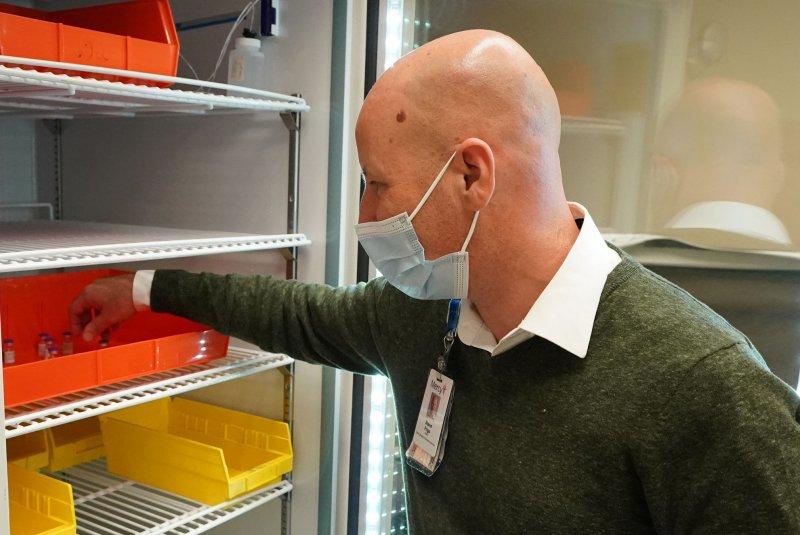 Steve Frigo, head of Pharmacy Services for Mercy Hospital, retrieves a vial of Pfizer's coronavirus vaccine from a freezer at Mercy Hospital in Creve Coeur, Mo., on December 14, 2020. File Photo by Bill Greenblatt/UPI