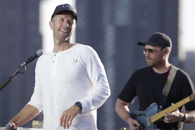 Chris Martin (L) and Coldplay perform during a sound check in June 2021. The band has released two new versions of their song with BTS titled My Universe. File Photo by John Angelillo/UPI