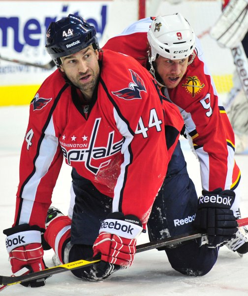 Washington Capitals Roman Hamrlik and Florida Panthers Stephen Weiss get tangled up on the ice during the third period at the Verizon Center in Washington, D.C. on April 5, 2012. UPI/Kevin Dietsch