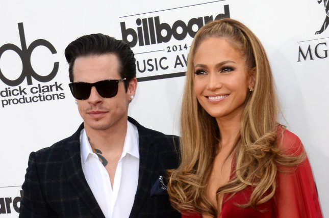 (L-R) Entertainers Casper Smart and Jennifer Lopez attend the 2014 Billboard Music Awards held at the MGM Grand Garden Arena in Las Vegas, Nevada on May 18, 2014. UPI/Jim Ruymen