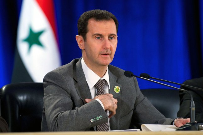 Saudi Arabian Foreign Minister Abdel Al-Jubeir has called on Syrian President Bashar al-Assad, pictured, to step down or be forcibly removed from power during peace negotiations in Riyadh. File photo by UPI