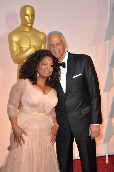 Oprah Winfrey and Stedman Graham arrived on the red carpet at the 87th Academy Awards on Feb. 22, 2015. She credits Graham with helping her stick to her Weight Watchers program. File Photo by Kevin Dietsch/UPI