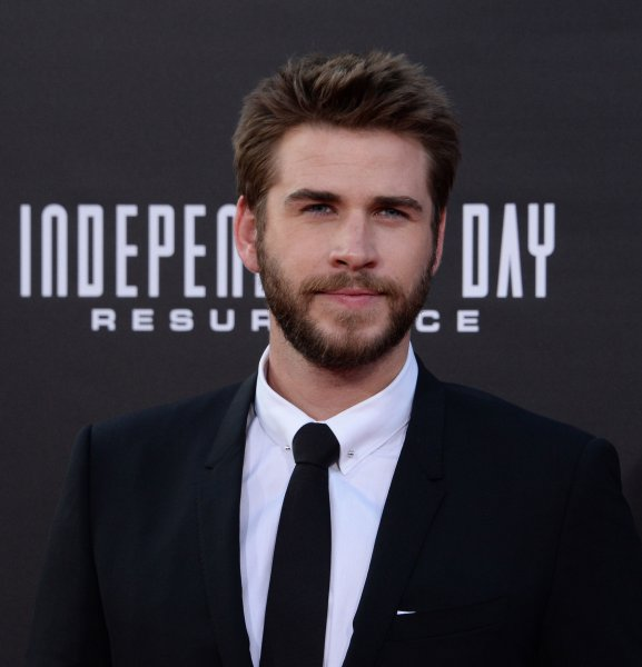 Cast member Liam Hemsworth attends the premiere of the sci-fi motion Independence Day: Resurgence at the El Capitan Theatre in Los Angeles on June 20, 2016. Hemsworth stopped by Conan and shared some of his adventures on Woody Harrelson's bus. Photo by Jim Ruymen/UPI