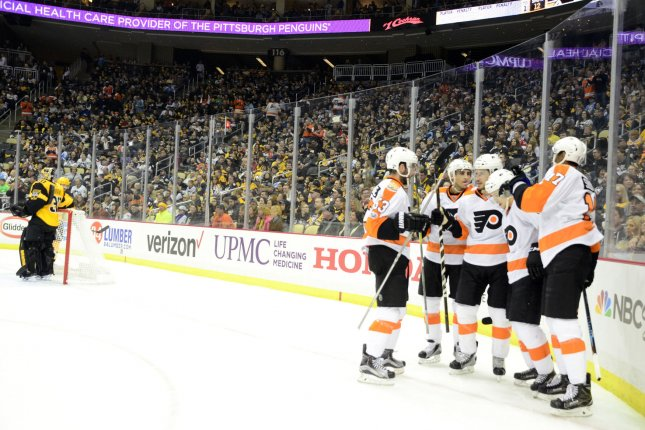 Philadelphia Flyers center Jordan Weal (40) (center) celebrates his goal the ties the game in the first period against the Pittsburgh Penguins at the PPG Paints Arena in Pittsburgh on March 26, 2017. Photo by Archie Carpenter/UPI