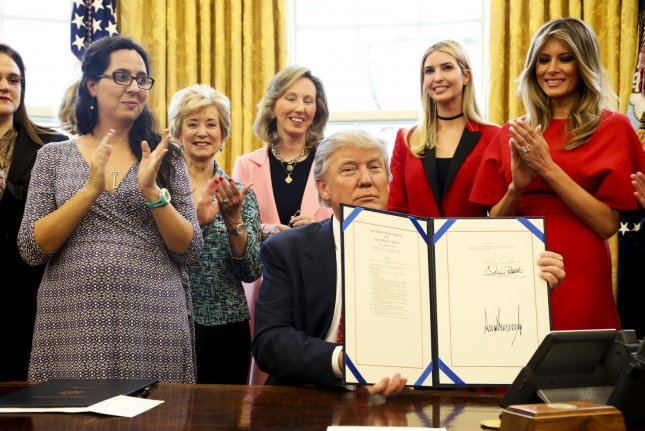 President Trump signs the H.R. 321 and H.R. 255, to increase women's participation in STEM fields through programs at NASA and the National Science Foundation on February 28, 2017. A study conducted in Germany suggests increased compulsory math courses don't encourage women to pursue careers in STEM -- and may actually have the opposite effect. Pool Photo by Aude Guerrucci/UPI