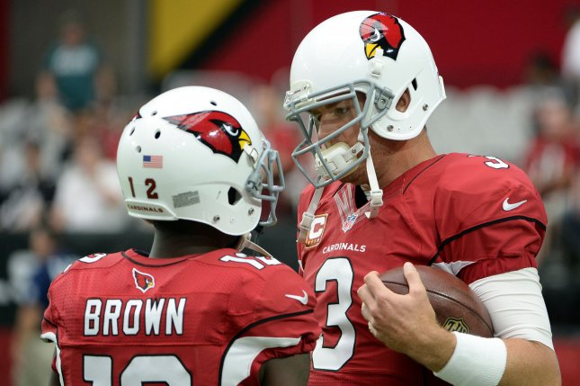 d3f213df765bde Arizona Cardinals quarterback Carson Palmer (R) talks with receiver John  Brown as they warms up before the Cardinals-San Francisco 49ers game at  University ...