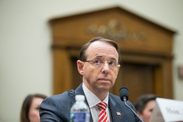 Deputy Attorney General Rod Rosenstein listens Wednesday to questions during a hearing on the Justice Department's investigation of Russia's interference in the 2016 U.S. presidential election in Washington, D.C. He said he consulted with the Department of Justice's inspector general before texts between two FBI agents were released. Photo by Erin Schaff/UPI