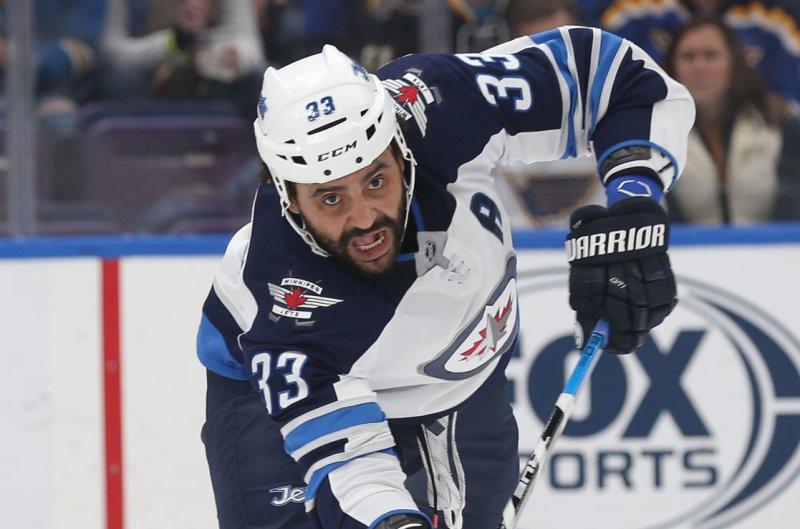 Winnipeg Jets defenseman Dustin Byfuglien will miss at least three games with a lower-body injury. File Photo by Bill Greenblatt/UPI