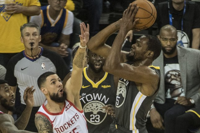 52849dc7548 Golden State Warriors forward Kevin Durant (R) matched reigning NBA MVP  James Harden with 29 points in a win against the Houston Rockets on Tuesday  in ...