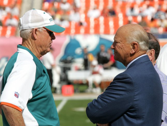 Miami Dolphins head coach Cam Cameron (L) talks to team owner Wayne Huizinga prior to the start of the game against the Cincinnati Bengals at Dolphin Stadium in Miami on December 30, 2007. The Bengals defeated the Dolphins 38-25 in the season ending game. (UPI Photo/Martin Fried)