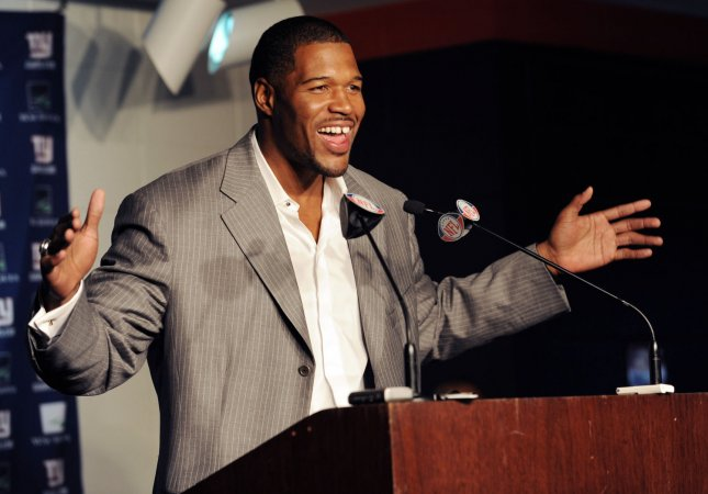 Michael Strahan, shown at the 2008 news conference in which he announced his retirement from the NFL, is among first-time finalists for consideration for induction to the Pro Football Hall of Fame. (UPI Photo/John Angelillo)