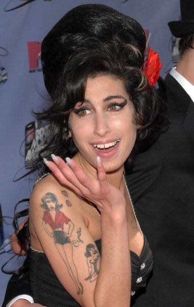 British singer Amy Winehouse was found dead in her home on July 23, 2011 in London. She was 27. She is shown at the MTV Movie Awards in Los Angeles, California on June 3, 2007. UPI/Jim Ruymen/Files
