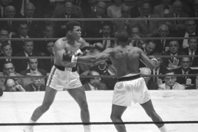 The 22-year old Cassius Clay (who later renamed himself Mohammed Ali) versus Sonny Liston in the famous World Heayweight Title fight that shook the boxing world on February 25, 1964 at the Convention Hall in Miami, FL. After this fight Cassius Clay changed his name to Muhammad X and then Muhammad Ali. (File/UPI Photo)