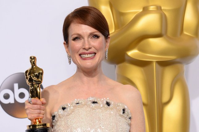 Julianne Moore, winner of Best Actress for role in Still Alice poses backstage with her Oscar during the 87th Academy Awards at the Hollywood & Highland Center in Los Angeles on February 22, 2015. Photo by Jim Ruymen/UPI
