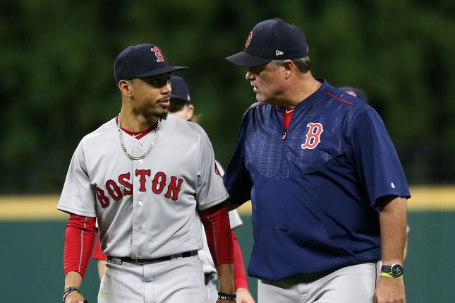 Boston Red Sox Xander Bogaerts leaves the field with manager John Farrell with an unknown injury during the seventh inning against the Cleveland Indians at Progressive Field in Cleveland, Ohio on August 24, 2017. File photo by Aaron Josefczyk/UPI