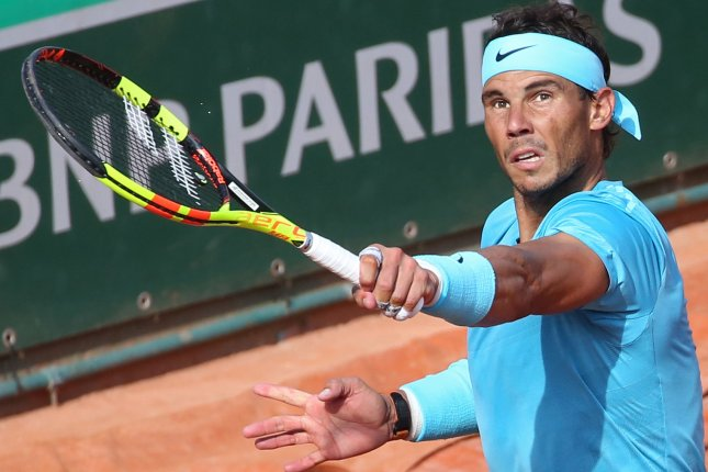 Rafael Nadal of Spain hits a shot during his French Open men's semifinal match against Juan Martin del Potro of Argentina Friday at Roland Garros in Paris. Photo by David Silpa/UPI