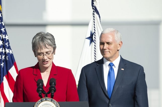 U.S. Air Force Secretary Heather Wilson, L, introduces Vice President Mike Pence at the Kennedy Space Center, Fla., on Dec. 18, 2018. Wilson announced her resignation on Friday. File Photo by Joe Marino-Bill Cantrell/UPI