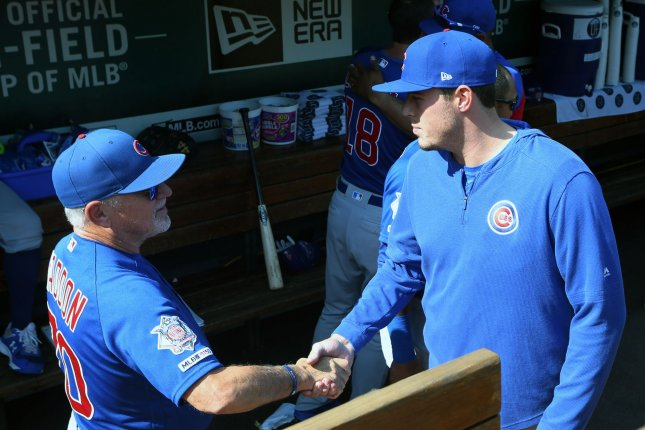 Chicago Cubs manager Joe Maddon and first baseman Anthony Rizzo meet in the team's dugout before a game against the St. Louis Cardinals Sunday at Busch Stadium in St. Louis. Photo by BIll Greenblatt/UPI