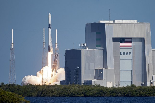 A SpaceX Falcon 9 rocket launches the Dragon capsule for NASA at 12:29 p.m. Wednesday from Complex 40 at Cape Canaveral Air Force Station, Fla.  Photo by Joe Marino-Bill Cantrell/UPI