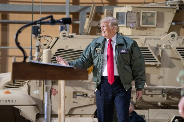 President Donald Trump arrives on stage at the U.S.-controlled al-Asad airbase in Iraq on December 26, 2018. The base was one of two attacked by Iran earlier this month. File Photo by Shealah Craighead/White House/UPI