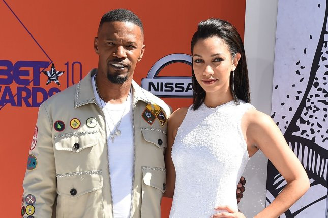 Jamie Foxx (L) and his daughter Corinne Foxx will co-executive produce the Netflix series Dad Stop Embarrassing Me. File Photo by Gregg DeGuire/UPI