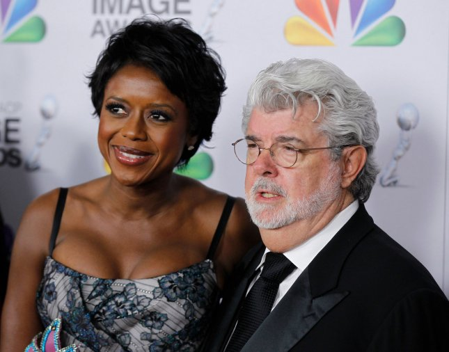 Mellody Hobson and filmmaker George Lucas arrive at the 43rd NAACP Image Awards at the Shrine Auditorium in Los Angeles on February 17, 2012. UPI/Danny Moloshok